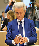Dutch far-right Party for Freedom (PVV) leader Geert Wilders sends a tweet in the courtroom of the courthouse in Schiphol, the Netherlands March 18, 2016. <br /> REUTERS/Michael Kooren