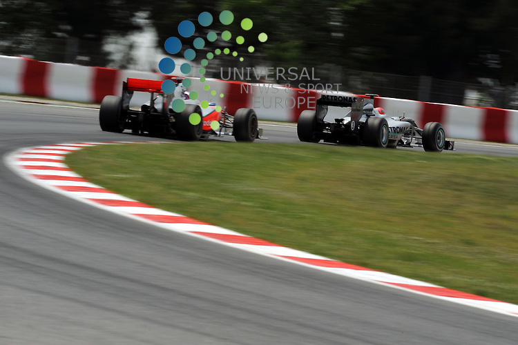 F1 GP of Spain, Barcelona 06.-09. May 2010.Jenson Button (GBR),  McLaren F1 Team  - Michael Schumacher (GER), Mercedes GP ..Hasan Bratic;Koblenzerstr.3;56412 Nentershausen;Tel.:0172-2733357;.hb-press-agency@t-online.de;http://www.uptodate-bildagentur.de;.Veroeffentlichung gem. AGB - Stand 09.2006; Foto ist Honorarpflichtig zzgl. 7% Ust.;Hasan Bratic,Koblenzerstr.3,Postfach 1117,56412 Nentershausen; Steuer-Nr.: 30 807 6032 6;Finanzamt Montabaur;  Nassauische Sparkasse Nentershausen; Konto 828017896, BLZ 510 500 15;SWIFT-BIC: NASS DE 55;IBAN: DE69 5105 0015 0828 0178 96; Belegexemplar erforderlich!..