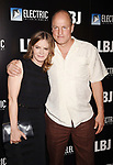 LOS ANGELES, CA - OCTOBER 24: Actress Jennifer Jason Leigh (L) and actor Woody Harrelson arrive at the premiere of Electric Entertainment's 'LBJ' at the Arclight Theatre on October 24, 2017 in Los Angeles, California.