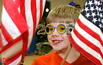 TORRINGTON, CT -31 DECEMBER 2005 -123105J01---Mitchell Canty, 9, of Torrington donning a pair of 2006 glasses, waves an American flag during a musical skit by entertainer T-Bone Stankus Saturday at the Torrington Last Night celebration at the Torrington Armory. The event was sponsored by the Torrington Parks and Recreation department.   --  Jim Shannon Republican-American--  Mitchell Canty; Torrington; T-Bone Stankus, Torrington Last Night are CQ