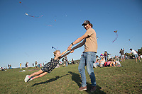 Dad enjoys spinning his daughter as people participate flying their kites during the Kite Festival in Zebegeny (about 70 kilometres north of capital city Budapest), Hungary on Sept. 15, 2018. ATTILA VOLGYI