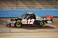 Nov. 13, 2009; Avondale, AZ, USA; NASCAR Camping World Truck Series driver Derek White during the Lucas Oil 150 at Phoenix International Raceway. Mandatory Credit: Mark J. Rebilas-