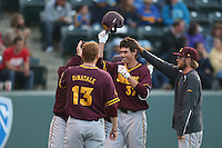 Colby Woodmansee #37 of the Arizona State Sun Devils is greeted by his teammates after hitting a home run during a game against the UCLA Bruins at Jackie Robinson Stadium on March 28, 2014 in Los Angeles, California. UCLA defeated Arizona State 7-3. (Larry Goren/Four Seam Images)