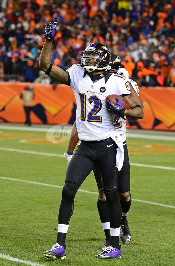 Jan 12, 2013; Denver, CO, USA; Baltimore Ravens wide receiver Jacoby Jones (12) celebrates a fourth quarter touchdown against the Denver Broncos during the AFC divisional round playoff game at Sports Authority Field.  Mandatory Credit: Mark J. Rebilas-