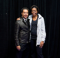 First Lady Michelle Obama stands with US Soccer Foundation Director David Sutphen during a US Soccer Foundation clinic held at City Center in Washington, DC.