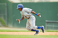Terrance Gore (6) of the Lexington Legends takes off for second base during the South Atlantic League game against the Kannapolis Intimidators at CMC-Northeast Stadium on July 31, 2013 in Kannapolis, North Carolina.  The Intimidators defeated the Legends 3-2.  (Brian Westerholt/Four Seam Images)