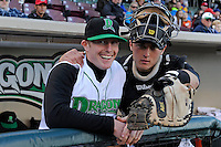 Dayton Dragons infielder Brent Peterson #2 and catcher Joe Hudson #18 before a game against the Bowling Green Hot Rods on April 20, 2013 at Fifth Third Field in Dayton, Ohio.  Dayton defeated Bowling Green 6-3.  (Mike Janes/Four Seam Images)