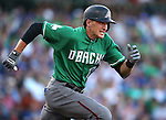 The Diamondbacks' Nick Ahmed runs up the first base line during a spring training game against the Chicago Cubs in Mesa, Ariz., on Thursday, March 17, 2016. The Cubs won 15-4. <br />Photo by Cathleen Allison