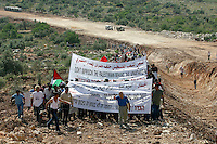 03.05.2003.Peace activists protest the building of the wall being built on Palestinian land..