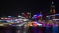 The Hong Kong skyline, as seen from Kowloon.  The effect was created in camera by zooming the lens during a long exposure.