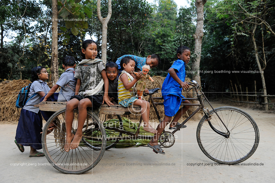 BANGLADESH Madhupur, Garo children play with bicycle rickshaw, Garos is a ethnic and christian religious minority / Bangladesch, Region Madhupur, Garo Kinder spielen mit einer Fahrrad Rikscha, Garos sind eine christliche u. ethnische Minderheit