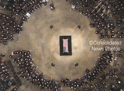 Hose Speaker Paul Ryan speaks as the late U.S. Sen. John McCain, R-Ariz., lies in state in the U.S. Capitol Rotunda Friday, Aug. 31, 2018, in Washington. (Pool photo by Morry Gash via AP)