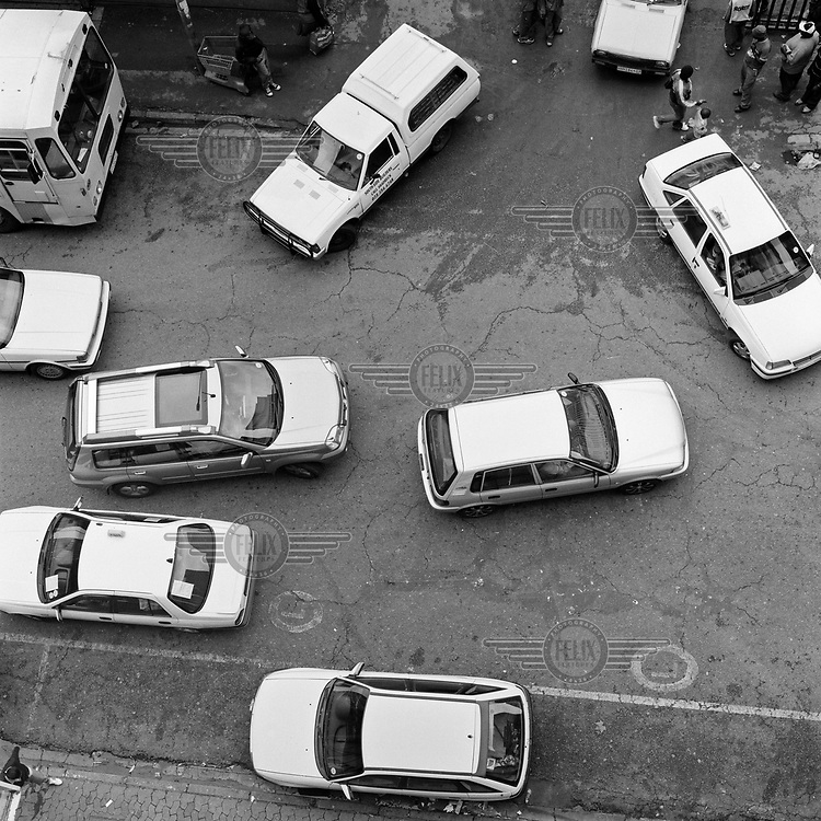 Traffic, viewed from above, negotiates Loveday Street.