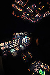 View of the flight deck on a B737 while fling at night