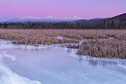 Snowcapped Presidential Range just after sunset from along the Presidential Range Rail Trail (Cohos Trail) at Pondicherry Wildlife Refuge in Jefferson, New Hampshire USA during the winter months.