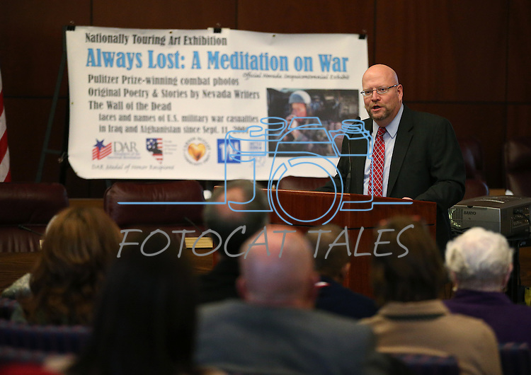 LCB Director Rick Combs speaks at the opening ceremony of the Always Lost: A Meditation on War exhibit at the Legislative Building in Carson City, Nev., on Monday, April 6, 2015. <br />