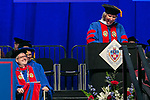 The Rev. Dennis H. Holtschneider, C.M., president of DePaul, listens to the remarks by honorary degree recipient Marty Wilke, broadcast television executive and DePaul alumna, Sunday, June 11, 2017, during the DePaul University College of Computing and Digital Media and the College of Communication commencement ceremony at the Allstate Arena in Rosemont, IL. (DePaul University/Jamie Moncrief)