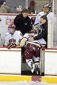 Bert Lenz (BC - Trainer) and Mike Feeley (BC - Student Manager) help Steven Whitney (BC - 21) - The Boston College Eagles defeated the University of Massachusetts-Amherst Minutemen 2-1 (OT) on Friday, February 26, 2010, at Conte Forum in Chestnut Hill, Massachusetts.