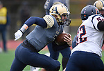Althoff quarterback Hayes Taylor runs a keeper play in the first half. The Althoff Catholic High School Crusaders defeated the Carterville Lions 42-0 in a first-round Illinois High School Association Class 4A football playoff game on Saturday October 28, 2017 in Belleville.