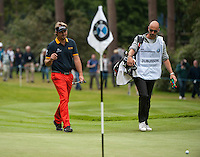 23.05.2015. Wentworth, England. BMW PGA Golf Championship. Round 3.  Victor Dubuisson [FRA] acknowledges the crowd as he walks on to the green, during the final round of the 2015 BMW PGA Championship from The West Course Wentworth Golf Club