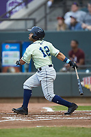 Ricky Aracena (12) of the Wilmington Blue Rocks follows through on his swing against the Winston-Salem Dash at BB&T Ballpark on April 17, 2019 in Winston-Salem, North Carolina. The Blue Rocks defeated the Dash 2-1. (Brian Westerholt/Four Seam Images)