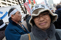 Protesters at an anti-nuclear power demo and occupy Tokyo protest outside the Ministry of the Economy, Trade and Industry (METI) in Tokyo, Japan. Friday 27th January 2012. The protest has been running from September 2011 and was scheduled for forcible eviction by police at 5pm on January 27th as the camp had been declared a fire risk by Minister Yukio Edano, with around 500 supporters and protesters turning up to resist the eviction however the camp was still in place the night of the 27th.