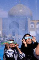 © Marcus Rose / Panos Pictures..Esfahan, IRAN..Women in Imam Square looking to the skies during the solar eclipse of August 1999.