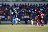February 26th 2020, the Mahinda Rajapaksha International Stadium, Hambantota, Sri Lanka; One Day International cricket, Sri Lanka versus West Indies; Avishka Fernando puts his bat down and runs to keep his wicket as Shai Hope watches the ball