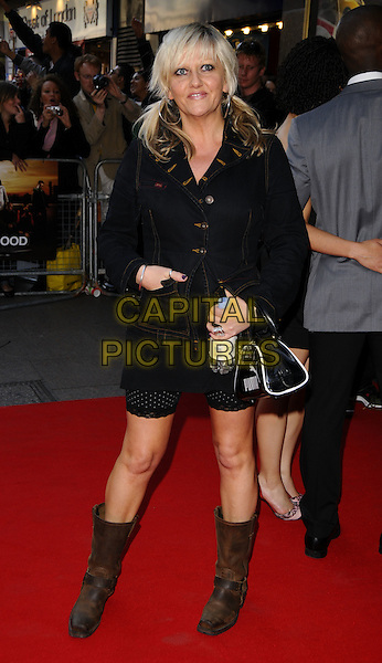 "CAMILLE CODURI.World Premiere of ""Adulthood"" held at the Empire Leicester Square, London, England, UK, .June 17th 2008 .arrivals full length denim jacket bag black water bottle bunches brown biker boots .CAP/CAN.©Can Nguyen/Capital Pictures."