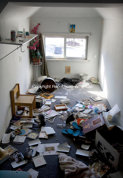 WATERBURY CT. 30 January 2014-013014SV13-An upstairs bedroom was destroyed in a house on Raymond Street after metal thieves, vandals and addicts destroyed Pany Malichanh&rsquo;s home while the family was away for three years in Waterbury Thursday.<br /> Steven Valenti Republican-American