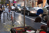 New York, NY - 2 December 2007 - Bicycles, Cars and vendors use the new shared lane on Prince Street in Soho