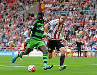 Bafetibis Gomis of Swansea City scores their first goal during the Barclays Premier League match between Sunderland and Swansea City played at Stadium of Light, Sunderland