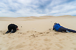 Getting low in the sand. Workshop Attendees at our Seascapes & Sandunes photography workshop in Port Stephens, NSW, Australia