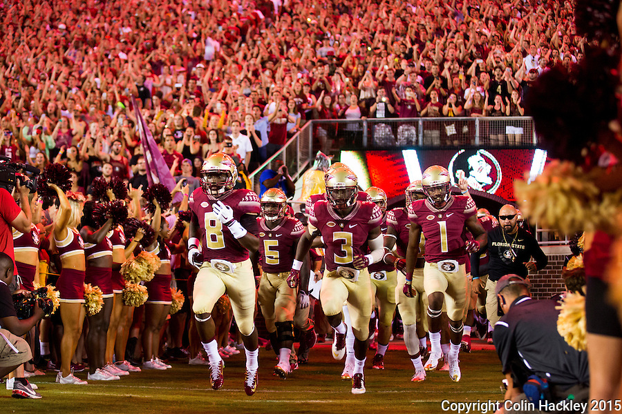 TALLAHASSEE, FLA. 9/5/15-Kermit Whitfield (8), left, Reggie Northrup (5) Jesus Wilson (3) and Ermon Lane (1) lead the Seminoles on to the field to open the curtain on the 2015 football season just before the Florida State University vs. Texas State University football game at Doak Campbell Stadium in Tallahassee.<br /> <br /> COLIN HACKLEY PHOTO