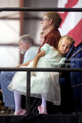 Belgrade, MT - August 14, 2009 -- A young girl in the audience sleeps in her chair as United States President Barack Obama addresses a town hall meeting on health care insurance reform inside a hangar at Gallatin Field in Belgrade, Montana, August 14, 2009..Mandatory Credit: Pete Souza - White House via CNP