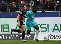 Jerome Roussillon (VfL Wolfsburg) gegen Erik Durm (Eintracht Frankfurt) - 23.11.2019: Eintracht Frankfurt vs. VfL Wolfsburg, Commerzbank Arena, 12. Spieltag<br /> DISCLAIMER: DFL regulations prohibit any use of photographs as image sequences and/or quasi-video.