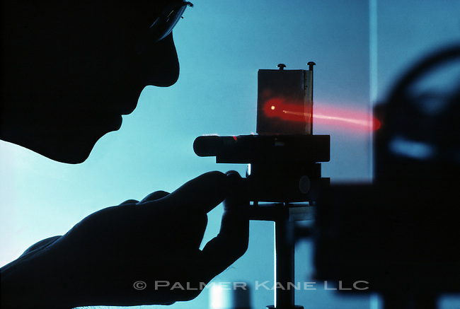 Scientist at an optical bench
