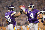 Minnesota Vikings quarterback Brett Favre (4) and full back Naufahu Tahi (38) celebrate a touchdown during an NFL football game against the Green Bay Packers at the Hubert H. Humphrey Metrodome on October 5, 2009 in Minneapolis, Minnesota. The Vikings won 30-23. (AP Photo/David Stluka)
