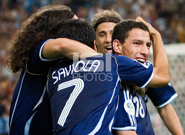 Teammates help Maxi Rodriguez (R) of Argentina celebrates his goal. Argentina defeated Serbia and Montenegro 6-0 in their FIFA World Cup Group C match at FIFA World Cup Stadium, Gelsenkirchen, Germany, June 16, 2006.