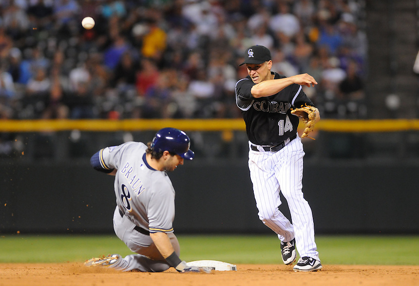 14 JULY 2011: Colorado Rockies second baseman Mark Ellis (14) attempts a double play past a sliding Milwaukee Brewers left fielder Ryan Braun (8) during a regular season game between the Milwaukee Brewers and the Colorado Rockies at Coors Field in Denver, Colorado. The Rockies beat the Brewers 12-3. *****For Editorial Use Only*****