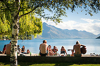 Locals and tourists enjoing lifestyle of  Queenstown on shores of Lake Wakatipu, Central Otago, South Island, New Zealand