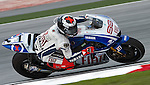 KUALA LUMPUR, MALAYSIA - OCTOBER 24:  Jorge Lorenzo of Spain rides the #99 Fiat Yamaha Team Yamaha during qualifying for the Malaysian MotoGP, which is round 16 of the MotoGP World Championship at the Sepang Circuit on October 24, 2009 in Kuala Lumpur, Malaysia.  Photo by Victor Fraile / The Power of Sport Images