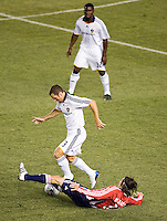Chivas USA midfielder Sacha Kljestan (16)  slide tackles LA Galaxy' defender Greg Vanney (3) during the Super Clasico MLS match. The LA Galaxy defeated Chivas USA 5-2 during the SuperClasico at the Home Depot Center Stadium, in Carson, California, Saturday, April 26, 2008.