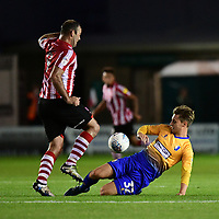 Lincoln City's Matt Rhead is fouled by Mansfield Town's Danny Rose<br /> <br /> Photographer Chris Vaughan/CameraSport<br /> <br /> The EFL Checkatrade Trophy Group H - Lincoln City v Mansfield Town - Tuesday September 4th 2018 - Sincil Bank - Lincoln<br />  <br /> World Copyright © 2018 CameraSport. All rights reserved. 43 Linden Ave. Countesthorpe. Leicester. England. LE8 5PG - Tel: +44 (0) 116 277 4147 - admin@camerasport.com - www.camerasport.com