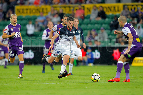 25th March 2018, nib Stadium, Perth, Australia; A League football, Perth Glory versus Melbourne Victory; Terry Antonis from Melbourne Victory challenges for the through ball as Shane Lowry of the Perth Glory moves in to clear