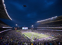 A Boeing C-17 rumbles over Husky Stadium on Salute to Service Night.