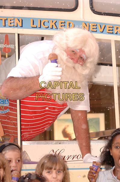 "FATHER CHRISTMAS.The opening of ""Christmas World"" at Harrods, Knightsbridge, London, England, 7th August 2007..half length ice-cream ice cream van kids children snow xmas santa claus.CAP/FIN.©Steve Finn/Capital Pictures."
