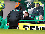 Fourth official Steve Conroy goes into the dugout to speak to Neil Lennon