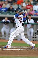 Tennessee Smokies shortstop Jeudy Valdez #12 swings at a pitch during a game against Huntsville Stars at Smokies Park on April 25, 2014 in Kodak, Tennessee. The Stars defeated the Smokies 15-1. (Tony Farlow/Four Seam Images)