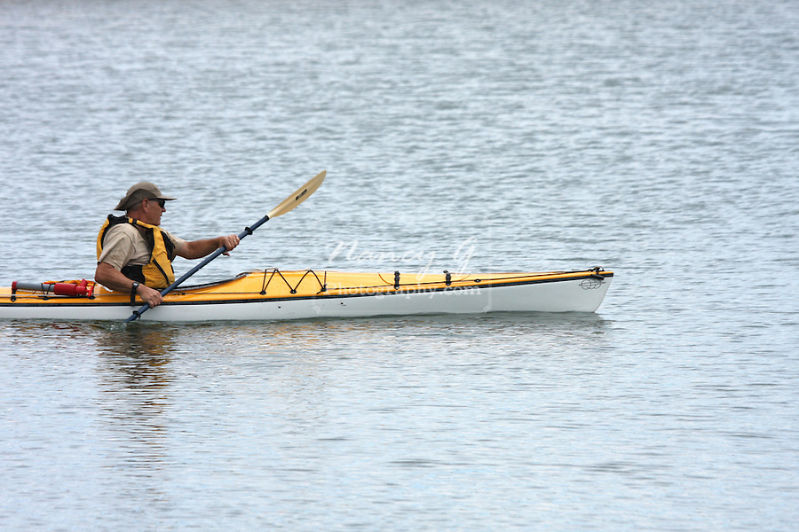 An older man enjoying kayaking the Milwaukee Harbor, Wisconsin in late Summer